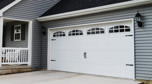 ----garagedoor-types_CarriageHouseStamped.jpg